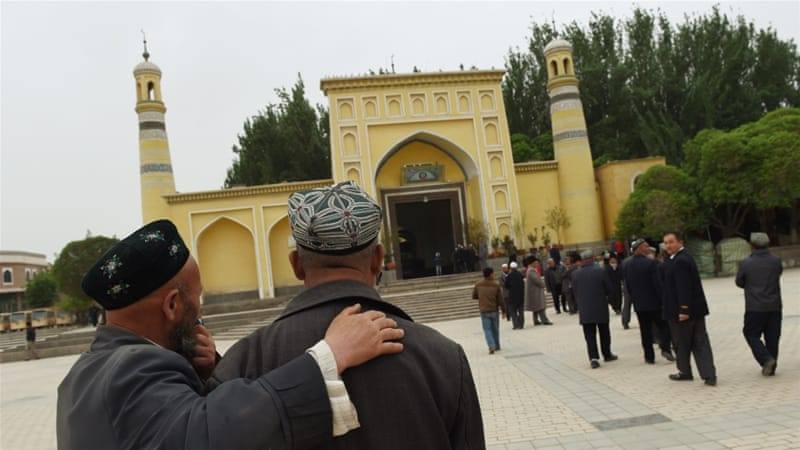 Uighur men making their way to the Id Kah mosque for afternoon prayers [Getty]