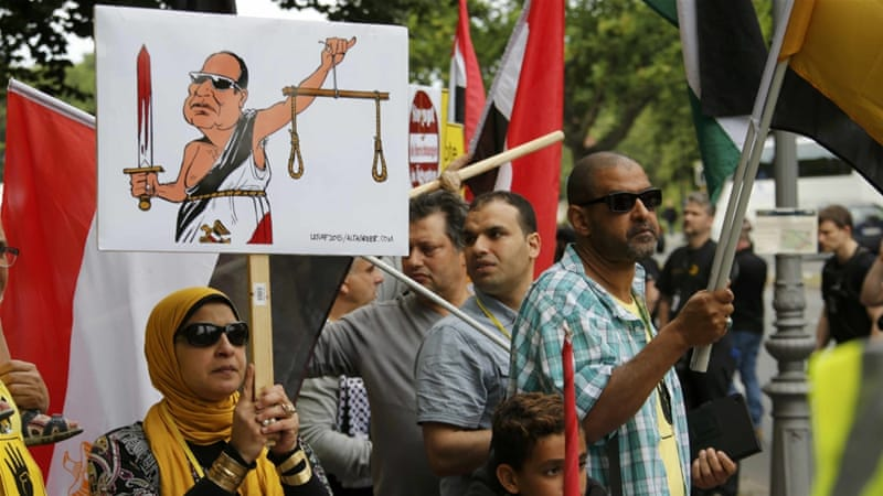 Protesters gathered in front of the presidential palace in Berlin to denounce Egypt's human rights record [Reuters]