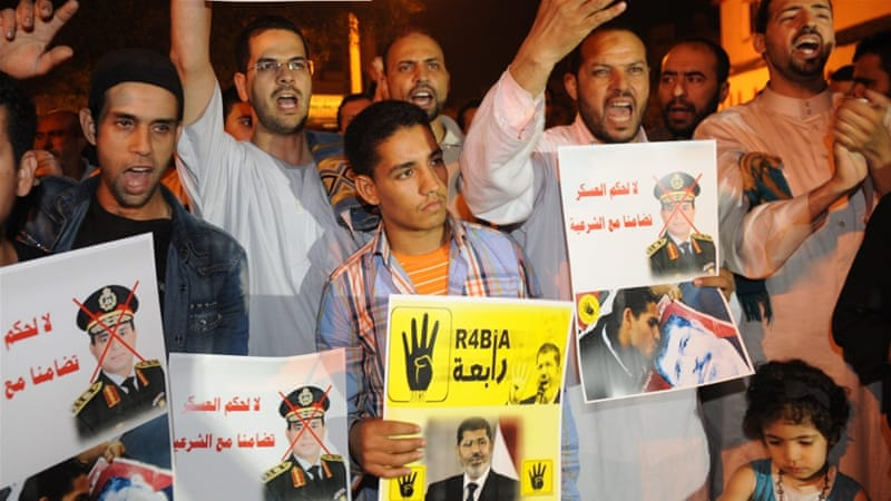 Activists protest against court's decision to seek death penalty for Morsi [EPA]