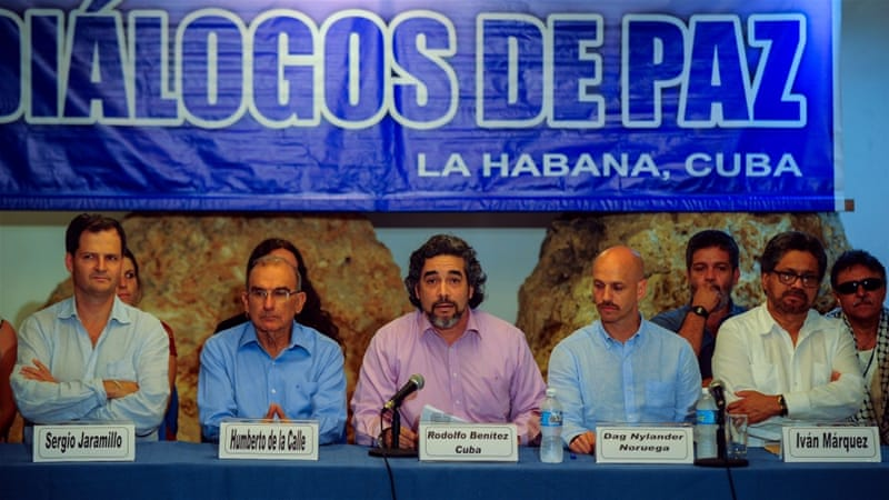 Cuban guarantor of the Colombia-FARC peace talks Rodolfo Benitez, centre, speaks during a news conference. [AFP]