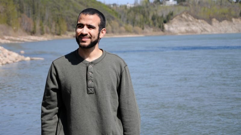 Omar Khadr enjoying his first long walk and bike ride after being freed, having spent nearly half of his life in custody [Getty]