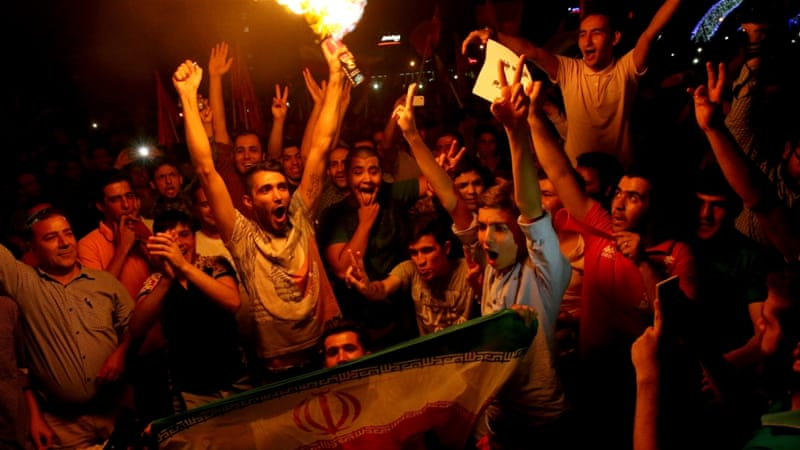 Jubilant Iranians cheered during street celebrations following a landmark nuclear deal in Tehran in July [Ebrahim Noroozi/AP Photo]