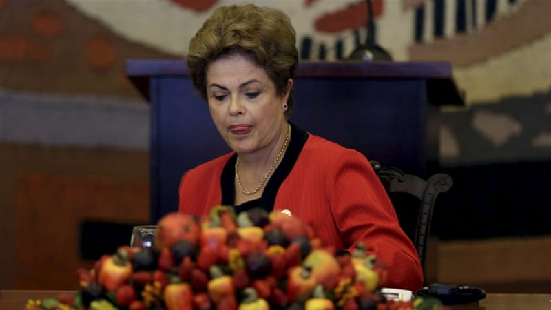 Rousseff is now facing two legal assaults and a steep recession [Ueslei Marcelino/Reuters]