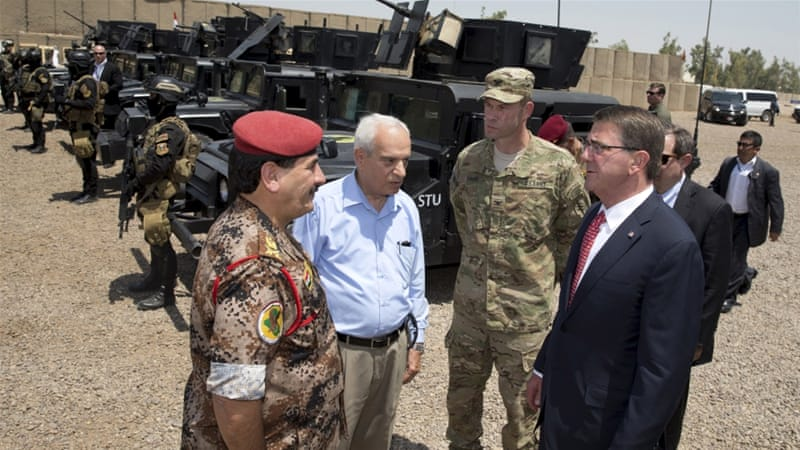 US Defence Secretary told US troops in Baghdad airport that progress is being made against ISIL [Reuters]