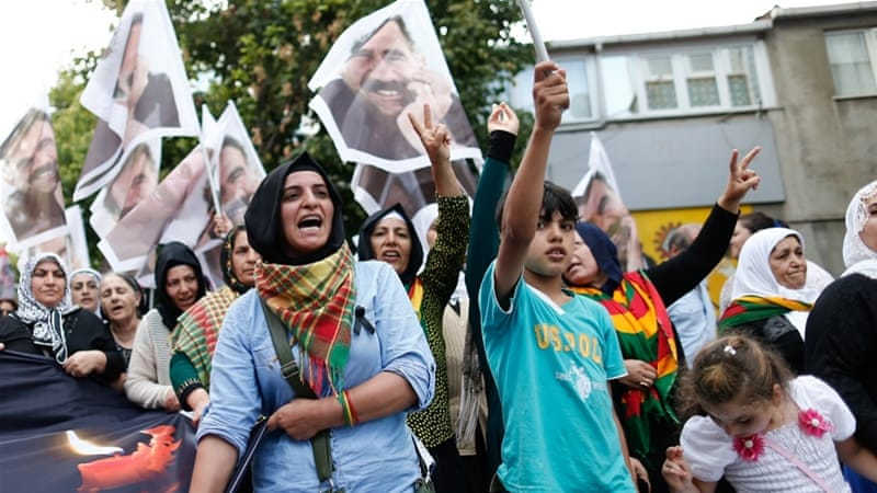 Protesters in Istanbul hold up photos of those who died in a recent suicide bombing in the Turkish border town of Suruc [EPA]