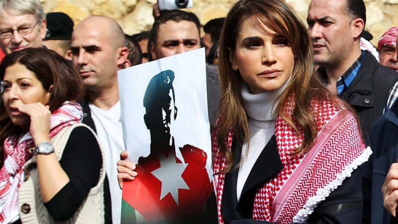 At a solidarity rally, Jordan's Queen Rania carried a photo of the Jordanian pilot who was executed by ISIL [EPA]
