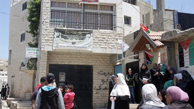 People gather at the al-Kasba family home on the day of Muhammad's funeral [Ylenia Gostoli/Al Jazeera]