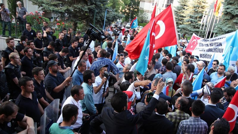 Several hundred protesters marched in Istanbul on Sunday chanting anti-China slogans outside the Chinese consulate [AFP]