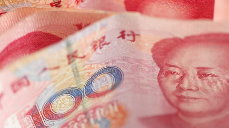 The move to devalue the yuan came after China's export fell 8.3 percent in July [EPA]