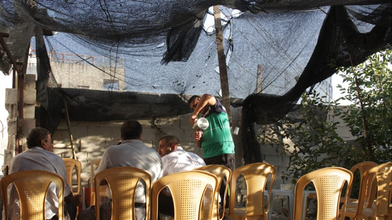 Abu Nab has erected a makeshift tent in front of his home and lined up plastic chairs for friends and neighbours [Ylenia Gostoli/Al Jazeera]