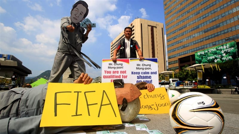 Protesters opposing the FIFA candidacy of Chung Mong-Joon [EPA]