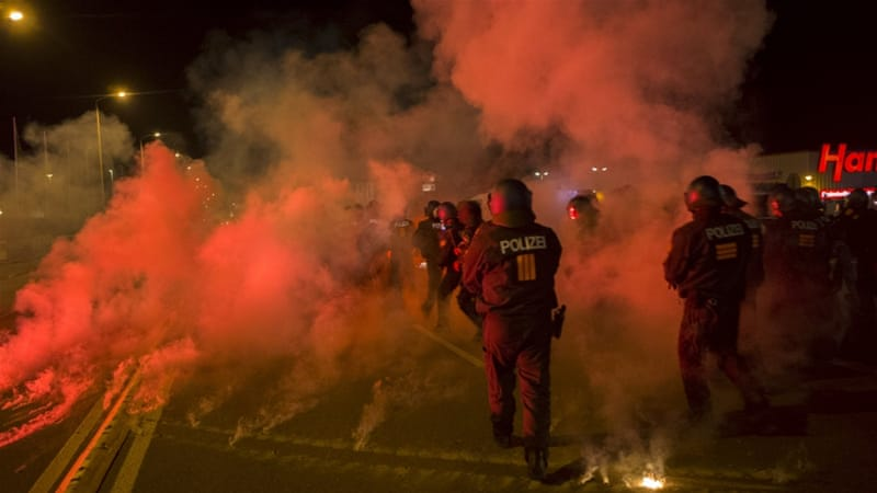 Dozens of police were injured when a far-right mob hurled bottles and fireworks at officers in Heidenau on Friday and Saturday [Reuters]