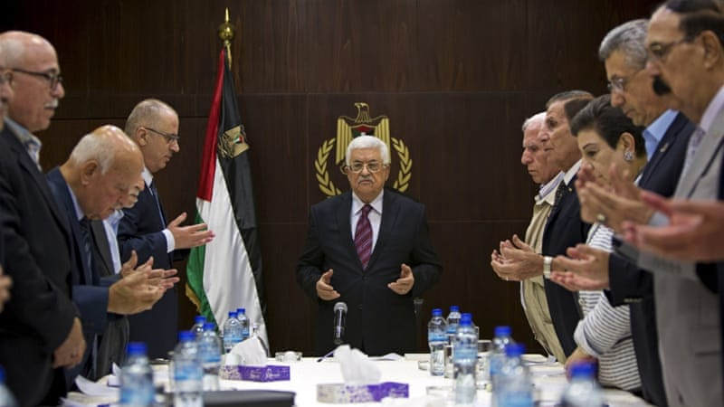 Abbas joins in a reading of the Quran prior to a meeting of the PLO executive committee in Ramallah [REUTERS]