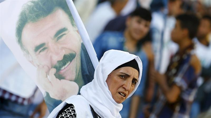 A demonstrator holds a portrait of Ocalan during a solidarity march in Diyarbakir, Turkey [File: Reuters]