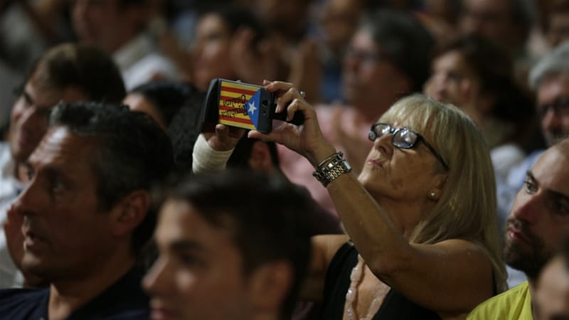 Polls show moast Catalans are in favour of a referendum even if they are almost evenly divided on independence [AP]