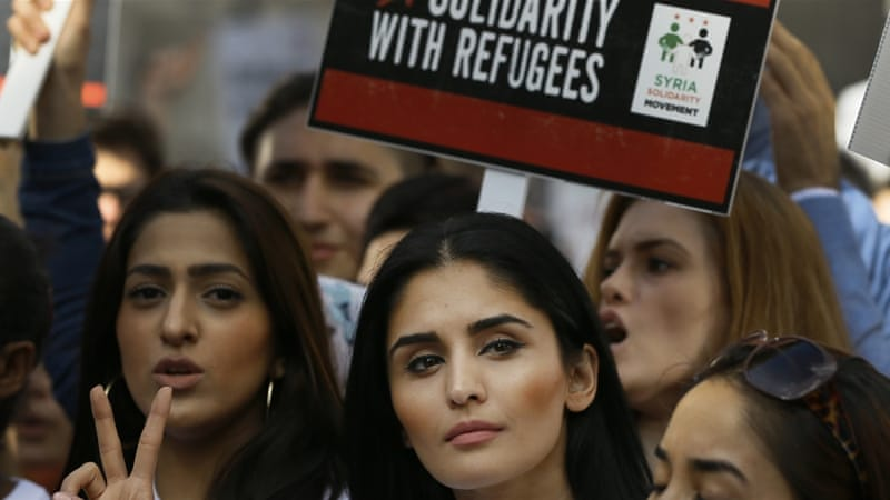 Thousands marched through London on Saturday waving placards saying 'Refugee lives matter' [AP]