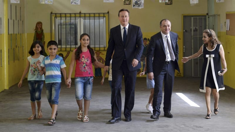 David Cameron met several refugees at the camp in the Bekaa Valley on Monday [Reuters]