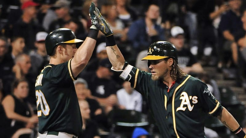 Josh Reddick (r) homered and drove in four runs for Oakland [AP]