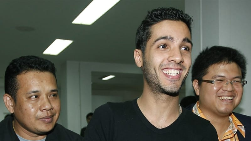 Hamza Bendelladj was dubbed the 'happy hacker' because he was photographed smiling after he was taken into custody in Bangkok [EPA]