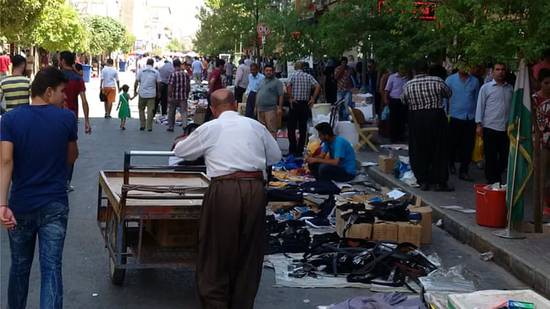 At Sulaimania's bazaar, which ought to have been buzzing with shoppers on the eve of Eid al-Adha, stall owners were both cynical and pessimistic [Tanya Goudsouzian/Al Jazeera]