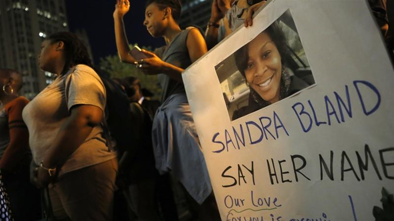 A demonstrator holds a Sandra Bland sign during a vigil on July 28, 2015 [File: Christian K Lee/AP Photo]
