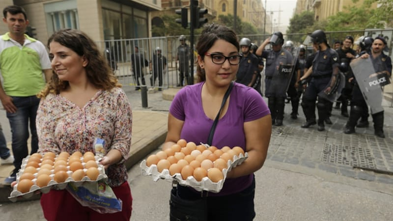 Lebanese anti-government protesters threw eggs at convoys of Lebanese politicians arriving at the parliament building [AP]