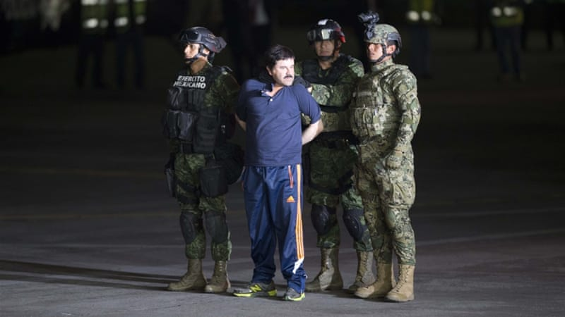 Interpol agents officially informed Guzman that he was wanted in the US [Eduardo Verdugo/AP]