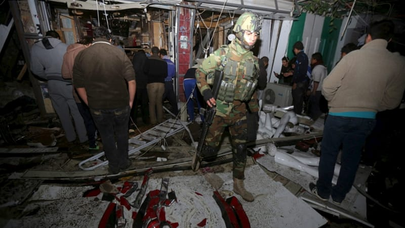 Gunmen charged into the mall after a car bomb exploded outside the building, in the largely Shia Muslim area of New Baghdad [AP]