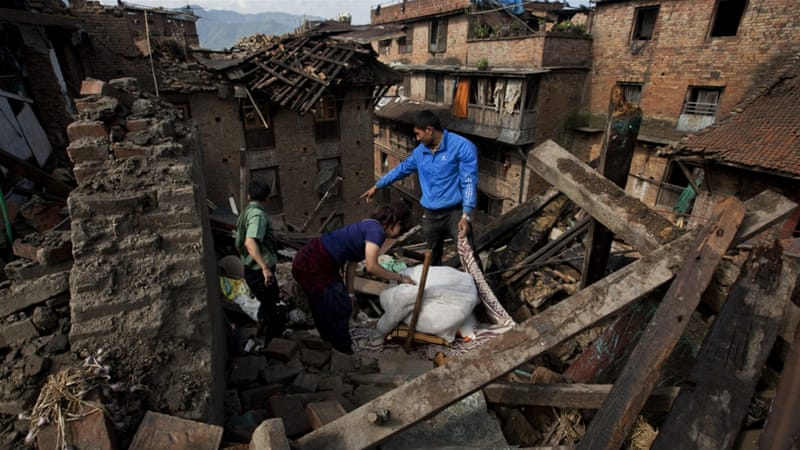 At least $3bn was pledged for relief efforts after the Nepal earthquakes last year [AP]
