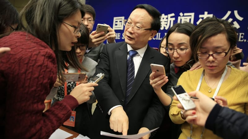 Wang Baoan, director of China's National Bureau of Statistics, points to a document as he speaks to reporters during a news conference. [EPA]
