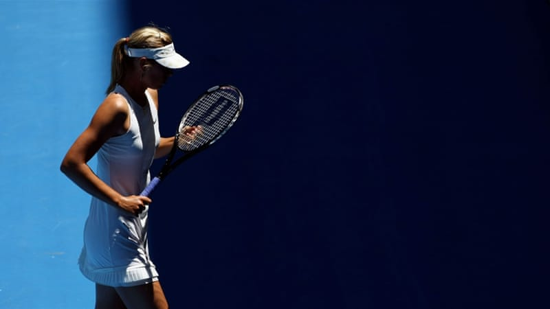 Maria Sharapova, with her back to the opponent, adjusts her strings [Getty Images]