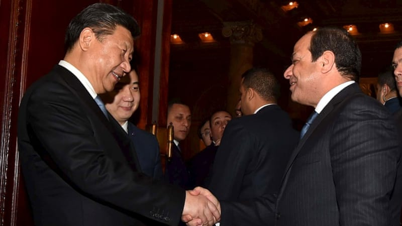 Egyptian President Abdel Fattah el-Sisi greets Chinese President Xi Jinping in Cairo, Egypt [REUTERS]