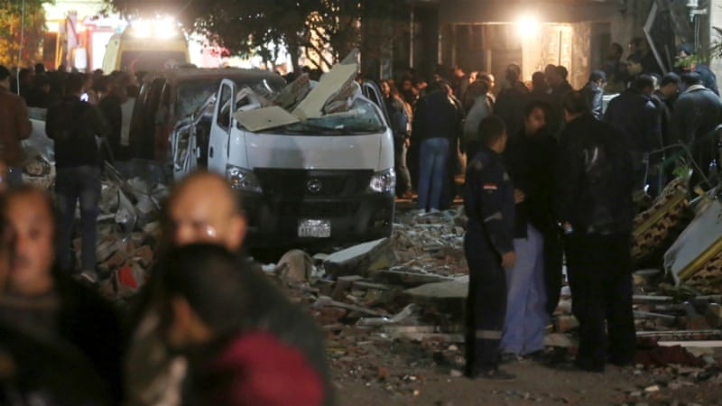 Damaged cars at the scene of the bomb blast in Giza on Thursday [Mohamed Abd El Ghany/Reuters]