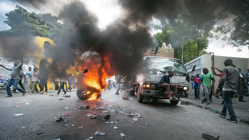 Violent demonstrations erupted in Haiti after elections were postponed indefinitely [Bahare Khodabande/EPA]