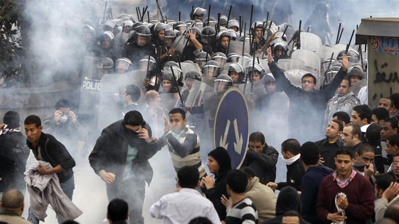 Egyptian anti-government activists clash with riot police in Cairo in January 2011 [File: Ben Curtis/AP]