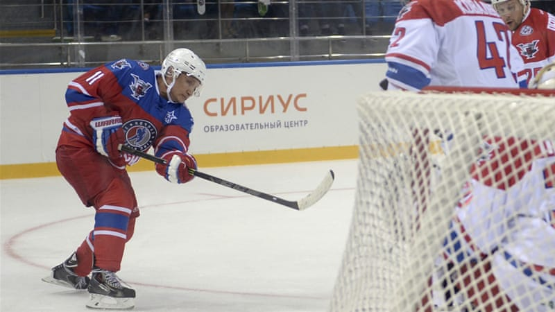 Vladimir Putin shoots a puck during a hockey game in October [Aleksey Nikolskyi/RIA Novosti/Kremlin]