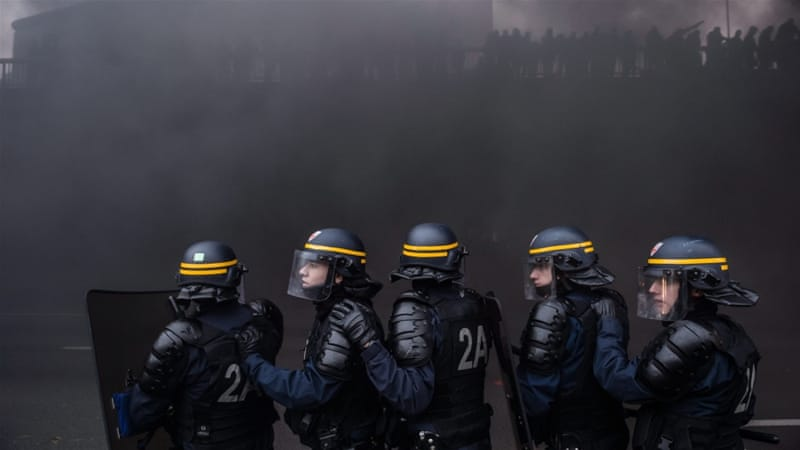 Police used tear gas to push back protesting taxi drivers, upset at their loss of market share to Uber [EPA]