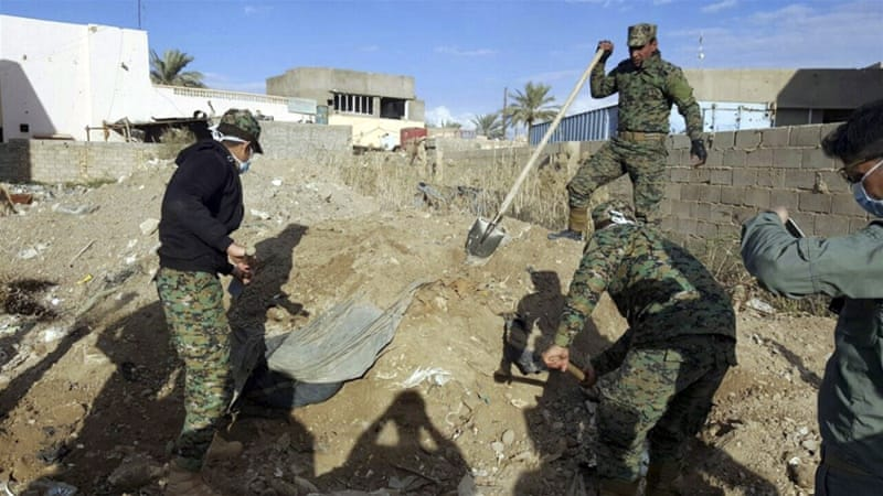 Iraqi forces also uncovered more than 40 bodies, including those of women and children, in a mass grave in Ramadi [AP]