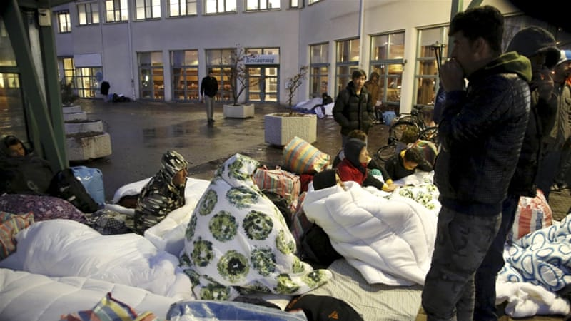 Refugees sleep outside the entrance of the Swedish Migration Agency's arrival centre for asylum seekers [File: Stig-Ake Jonsson/Reuters]