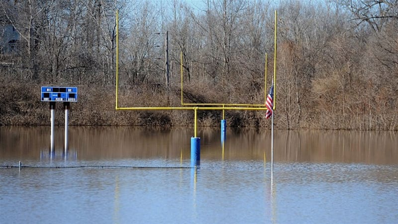 Flooding means it will be some time before the football field in Arnold, Missouri is playable [AFP]