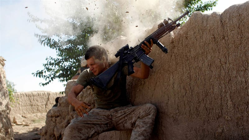 US Marine William Olas Bee has a close call after Taliban fighters open fire near in Helmand in this 2008 file photo [Goran Tomasevic/Reuters]