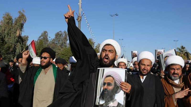Iraqi Shia protesters chanted slogans against the Saudi government as they held posters showing the executed cleric, Nimr al-Nimr [AP]