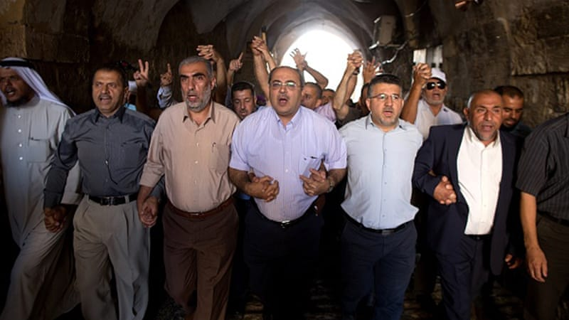 Arab Israeli Knesset member Ahmad Tibi takes part in a demonstration in a street in the Muslim quarter of Jerusalem's Old City [Getty]