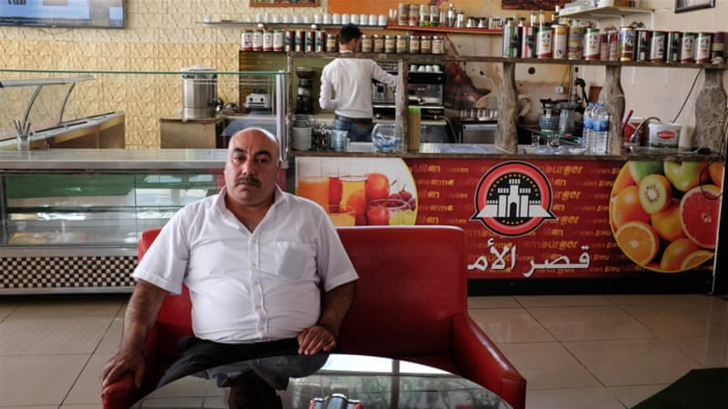 The economy of Gaziantep has benefited from the large inflow of Syrians, says cafe owner Ali Yousef [Megan O'Toole/Al Jazeera]