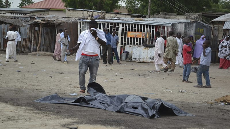 A body lies covered after an explosion in Maiduguri, Nigeria on Wednesday [Jossy Ola/AP]