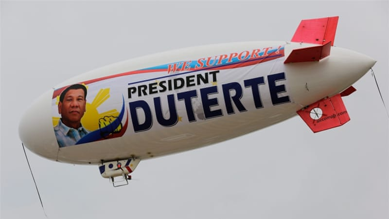 A blimp with a banner supporting Philippine President Rodrigo Duterte flies along Manila Bay in Manila, Philippines [EPA]