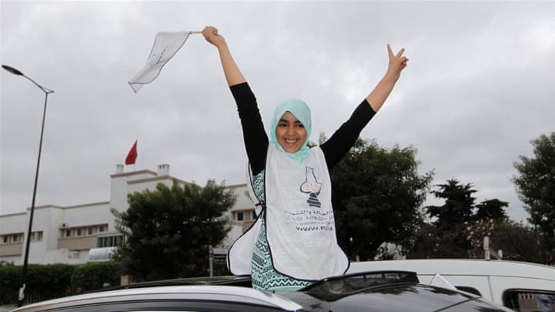 People celebrate after official parliamentary election results were announced in Rabat, Morocco [Reuters]