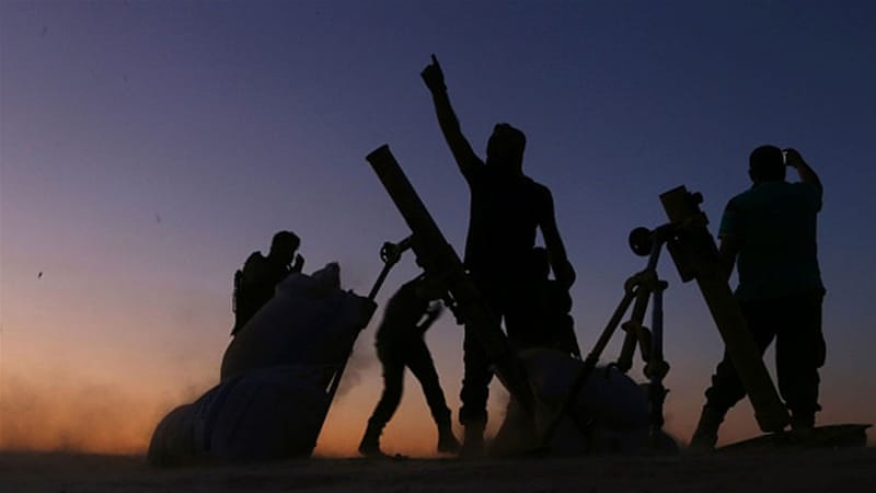 FSA fighters cheer and react as they fight against ISIL on the outskirts of the northern Syrian town of Dabiq [Getty]