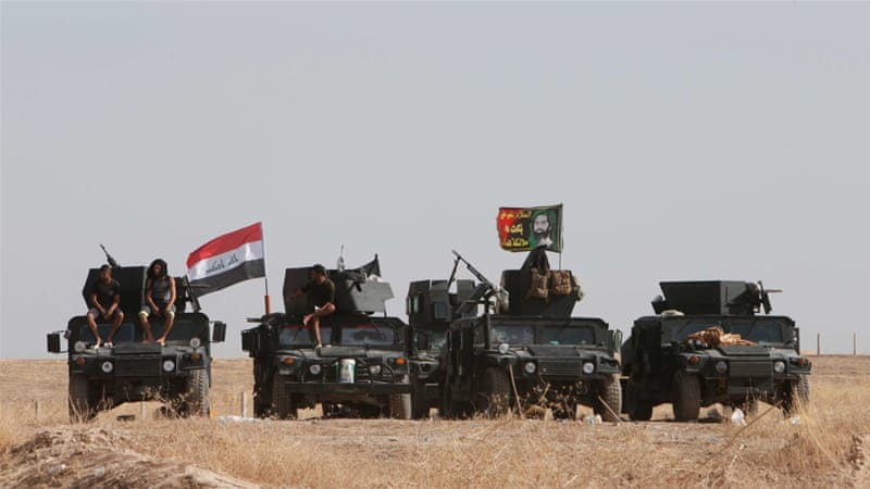 Iraqi security forces gather on the east of Mosul during preparations to attack Mosul, Iraq [Reuters]