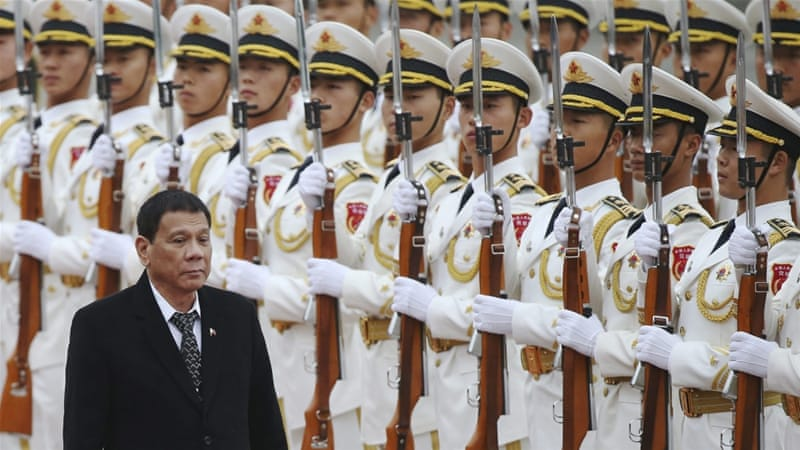 Philippines President Rodrigo Duterte review honour guards during a welcome ceremony at the Great Hall of the People in Beijing, October 2016 [EPA]